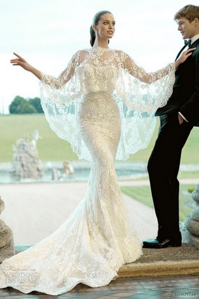 White wedding gown fully decorated with laces 2028588 weddbook junglespirit Image collections